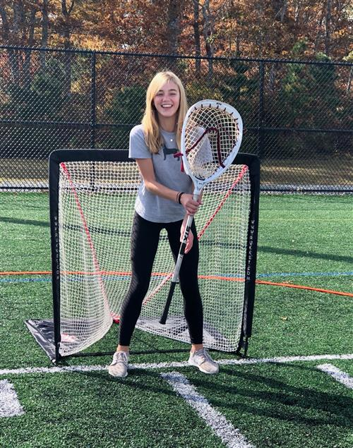 student playing lacrosse goalie