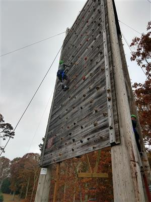 Student on climbing wall in adventure education