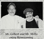 Mr. Gilbert and Mr. Mello enjoy homecoming