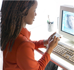 Woman using a computer to video conference