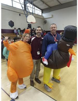 Three physical education and health teachers dressed for the turkey trot